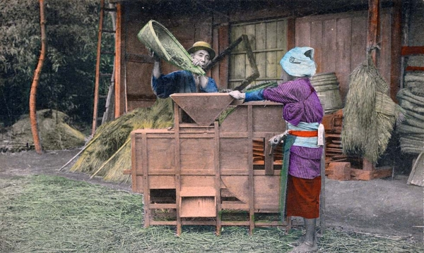 """Winnowing of ride [i.e., rice] with hand and machine."" 1910-1919. (New York Public Library)"