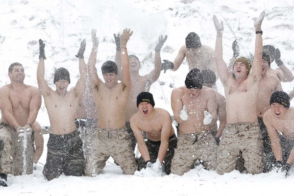 U.S. Marines from 3rd Marine Expeditionary force deployed from Okinawa, Japan, cover themselves in snow with South Korean marines during a winter military exercise on January 28, 2016 in Pyeongchang, South Korea. (Chung Sung-Jun/Getty)