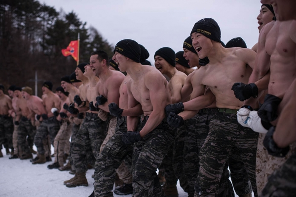 South Korean and U.S. soldiers shout during a joint annual winter exercise in Pyeongchang, South Korea on January 28, 2016. (Ed Jones/AFP/Getty)