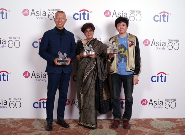 (L to R) Cai Guo-Qiang, Nalini Malani, and Yoshitomo Nara pose with their Asian Art Game Changer awards in Hong Kong on March 20, 2016.