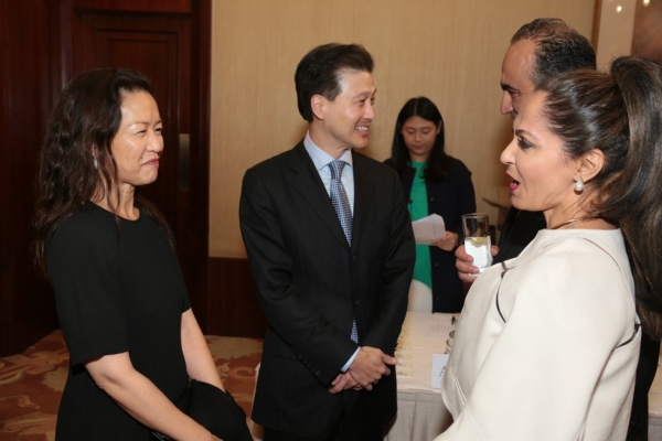 From left to right: Ellen and Dominic Ng, Chairman and CEO of East West Bank, and guests.