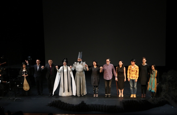 The opera singers, composer, librettists, and director are joined by the ensemble of behind-the-scenes designers and musicians that contribute to the production of 'Paradise Interrupted' on April 5, 2016. (Ellen Wallop/Asia Society)