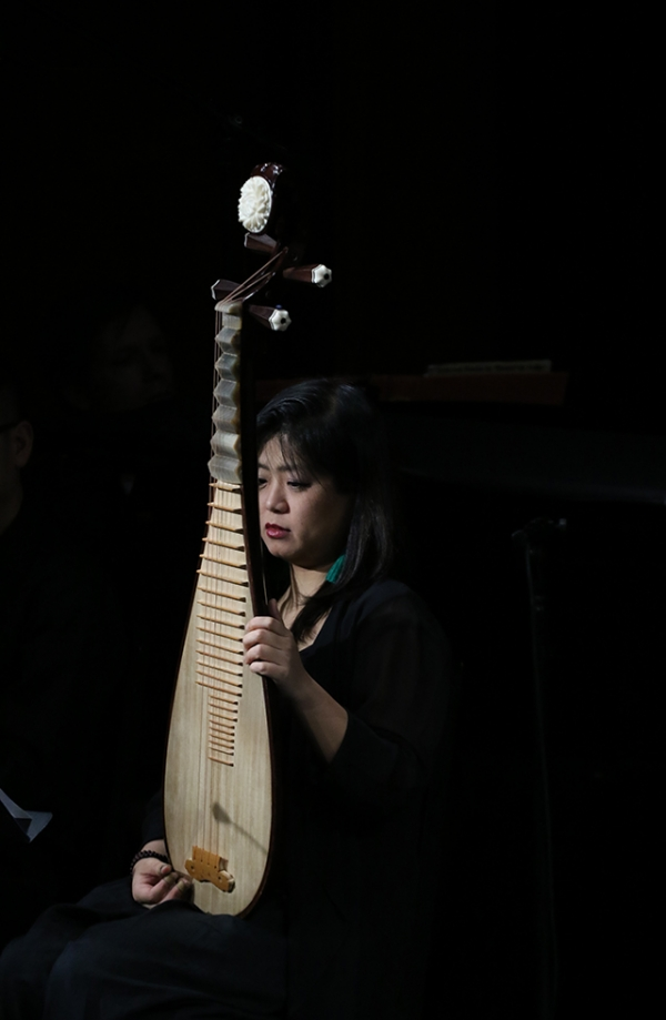 A member of the musical ensemble Zhou Yi play the Chinese pipa during a demonstration of 'Paradise Interrupted' on April 5, 2016. (Ellen Wallop/Asia Society)