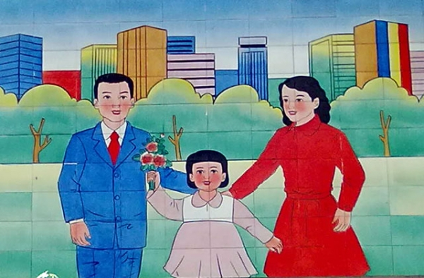 A mural in a village near Beijing stresses adherence to China's birth limits. (Eric Fish/Asia Society)