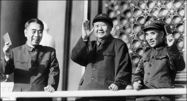 (L to R) Prime Minister Zhou Enlai, Chairman Mao Zedong, and Minister of Defense Lin Biao wave at Tiananmen Square in Beijing on October 3, 1967 as they review troops celebrating the 18th anniversary of the Republic. (AFP/Getty Images)