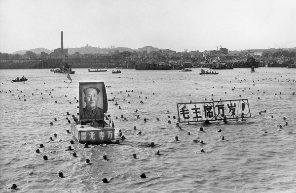 "Some 5,000 Chinese follow Chairman Mao Zedong's example and swim in the Yangtze River near Wuhan in September 1967. They displayed floating portraits of Mao and slogans calling for him to ""live 10,000 years."" (STR/AFP/Getty Images)"
