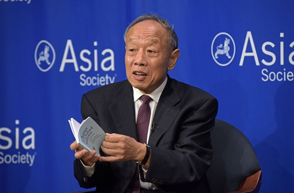 Former Chinese Foreign Minister Li Zhaoxing holds a copy of the Charter of the United Nations at Asia Society in New York. (Elsa Ruiz/Asia Society)