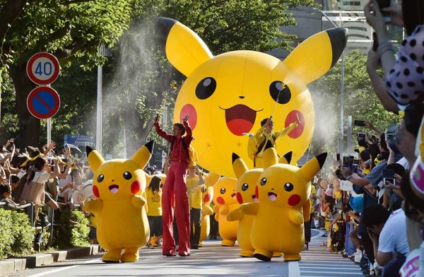 Performers dressed as Pikachu, the popular animation Pokemon series character, perform in the Pikachu parade in Yokohama on August 7, 2016. Some 50 life-size Pikachu characters, the most famous from the Pokemon game, marched along the city's waterfront street as visitors took mobile phone pictures and videos of them in scorching sunshine.  (Kazuhiro Nogi/AFP/Getty Images)