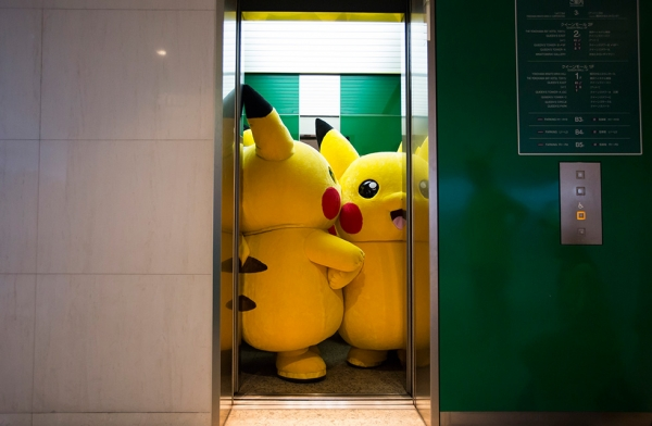 Performers dressed as Pikachu ride on an elevator during the Pikachu Outbreak event. (Tomohiro Ohsumi/Getty Images)