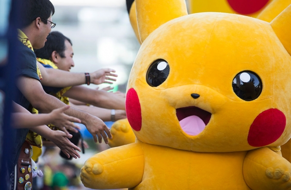 Performers dressed as Pikachu march during the Pikachu Outbreak event on August 7, 2016 in Yokohama, Japan. (Tomohiro Ohsumi/Getty Images)