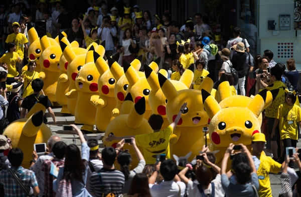 Performers march during the Pikachu Outbreak event hosted by The Pokémon Co. on August 7, 2016 in Yokohama, Japan. (Tomohiro Ohsumi/Getty Images)