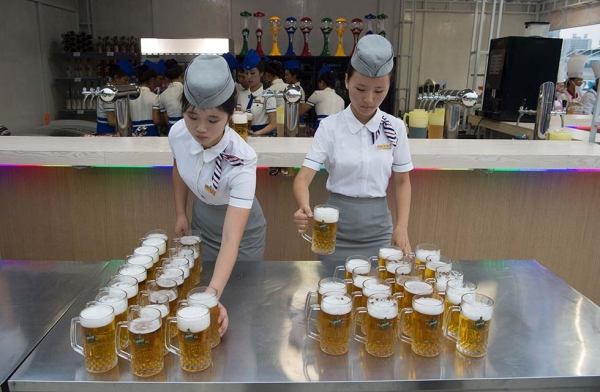 Waitresses prepare jugs of beer before the opening of the Pyongyang Taedonggang Beer Festival. (Kim Won-jin/AFP/Getty Images)