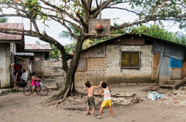 In the poorer villages, basketball hoops and backboards are made from whatever materials are available and fixed onto trees or makeshift wooden structures. Cebu, Philippines. (Richard James Daniels)
