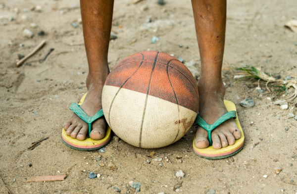 In the local villages of Cebu, Philippines, kids and adults will play basketball in flip flops on pretty rough terrain. (Richard James Daniels)