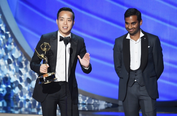 Actor/writer Aziz Ansari (R) and writer Alan Yang accept Outstanding Writing for a Comedy Series for the 'Master of None' episode 'Parents' onstage during the 68th Annual Primetime Emmy Awards at Microsoft Theater on September 18, 2016 in Los Angeles, California. (Kevin Winter/Getty Images)