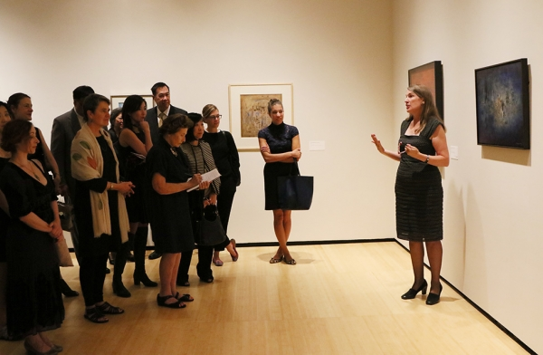 Dr. Ankeney Weitz the Ellerton M. and Edith K. Jetté Professor of Art, Colby College and co-curator of 'No Limits: Zao Wou-Ki' leads a group of members on a tour of the exhibition in New York on September 12, 2016. (Ellen Wallop/Asia Society)