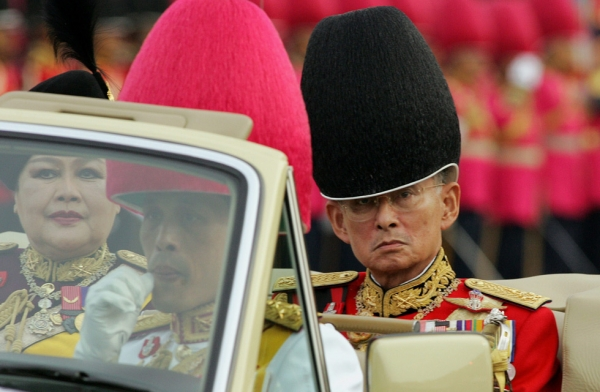 Thai King Bhumibol Adulyadej (R), Queen Sirikit and Crown Princess Maha Vajiralongkorn (F) return after reviewing the honor guard as a part of the celebration to commemorate his 78th birthday at the Royal Plaza in Bangkok, December 2, 2005. (Saeed Khan/Getty Images)