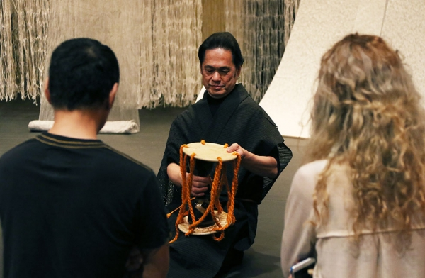 Japanese Noh drummer Shonosuke Okura leads a workshop on the drum he used during his performance of 'Recycling: Washi Tales' in New York on March 26, 2016. (Asia Society/Ellen Wallop)