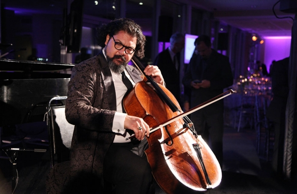 2016 Asia Game Changer and Iraqi cellist Karim Wasfi plays a moving piece at the Asia Game Changer Awards Gala at the United Nations Headquarters in New York on October 27, 2016. (Asia Society/Ellen Wallop)