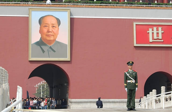 A soldier stands guard in front of Mao Zedong's portrait at Tiananmen Square in Beijing. (Matt Spurr/Flickr)