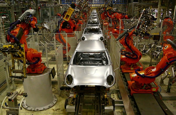 Robotic arms work on the body shells of cars on an automated production line at the BMW Mini car production plant in Oxford, England. (Goeff Caddick/AFP/Getty)
