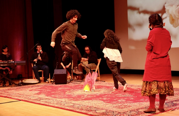 "Performers from J-Hoon Musical Ensemble participate in the Nowruz tradition of ""chaharshanbeh suri,"" or fire jumping, at Asia Society New York on March 18, 2017. (Ali Yousefian/Asia Society)"