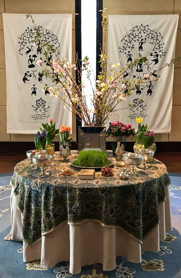 "Celebrants put together a shared ""Haft-Seen,"" a typical celebratory table spread, at Asia Society New york on March 18, 2017. (Ali Yousefian/Asia Society)"
