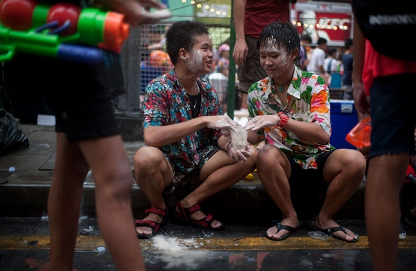 Two Thai young use chalk, water mixed with mentholated talc used for blessings, during the Songkran water festival in Silom road on April 13, 2015 in Bangkok, Thailand. (Borja Sanchez-Trillo/Getty Images)