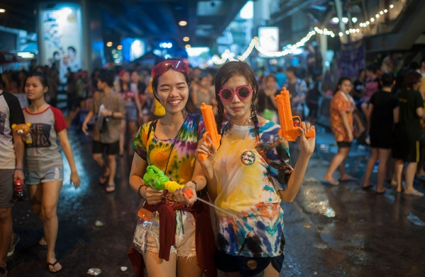 Revellers take part in a water fight during the Songkran water festival in Silom road on April 13, 2015 in Bangkok, Thailand. (Borja Sanchez-Trillo/Getty Images)