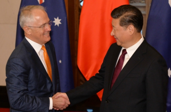 Chinese President Xi Jinping (R) shakes hands with Australian Prime Minister Malcolm Turnbull before their meeting at the Diaoyutai State Guesthouse in Beijing on April 15, 2016. (Kenzaburo Fukuhama/AFP/Getty Images)