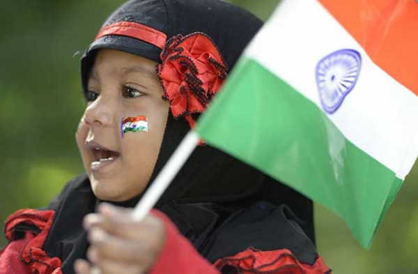 An Indian girl holds a flag during Independence Day celebrations in Secunderabad, the twin city of Hyderabad, on August 15, 2017. (Noah Seelam/AFP/Getty)