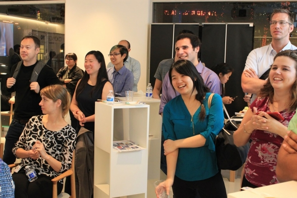 People chuckle with amusement during the presentations. (Minlu Gan/Asia Society)