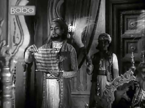 Rocking the mic at the Mughal court, circa mid-1800s: Mushaira scene from the film Mirza Ghalib (1954).
