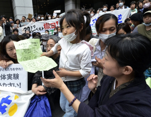 A girl holds her petition to ask the education ministry to protect children from radioactive contamination at Fukushima prefecture during a rally at the Education Ministry in Tokyo on May 23, 2011. (Yoshikazu Tsuno/AFP/Getty Images)