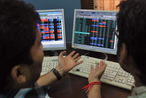 Indian stockbrokers react as they monitor share prices during intraday trade at a brokerage firm in Mumbai on August 5, 2011. Indian shares plunged by nearly four percent to its lowest point in over a year, triggered by US economic worries and the European debt crisis which have spooked world markets. (Indranil Mukherjee/AFP/Getty Images)