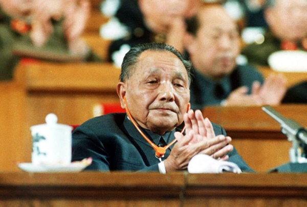 A file photo dated 25 Oct. 1987 shows China's late political patriarch Deng Xiaoping as he applauds during a session of the National People's Congress at the Great Hall of the People. (John Giannini/AFP/Getty Images)