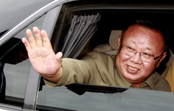 North Korean leader Kim Jong Il waves from a car after the meeting with Russian President Dmitry Medvedev at Sosnovy Bor Military Garrison, Zaigrayevsky District, Buryatia outside Ulan-Ude on August 24, 2011. (Dmitry Astakhov/AFP/Getty Images)
