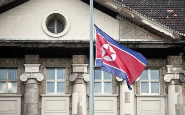 The flag of the Democratic Republic of Korea (DPRK) flies at half-mast in front of the embassy in Berlin December 19, 2011, following the death of North Korean leader Kim Jong Il.  (John MacDougall/AFP/Getty Images)