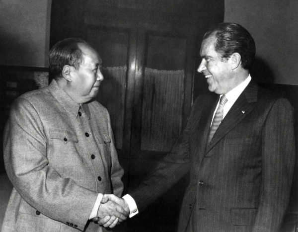 Chinese President Mao Zedong shake hands with Richard Nixon after their meeting in Beijing, China on February 22, 1972 during Nixon's official visit to China. (AFP/Getty Images)