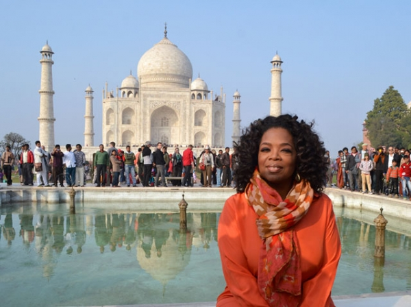 Oprah Winfrey in front of the Taj Mahal on January 19, 2012. Winfrey was on her first visit to India to film an episode of her show 'Oprah's Next Chapter.' (STRDEL/AFP/Getty Images)