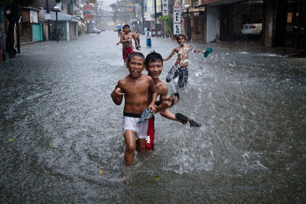 Young boys still keep smiling after the typhoon Soala in Manila, Philippines on August 9, 2012. (Matt Paish 2011/Flickr)