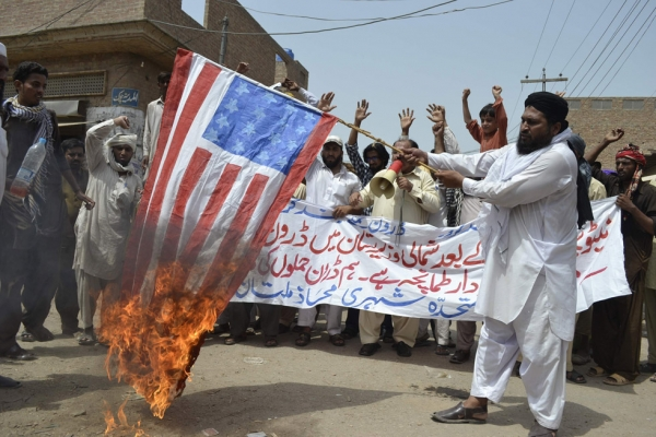 An activist of Muttahida Sheri Mahaz burns US flag during a protest in Multan on July 7, 2012, against a recent US drone attack. (S S Mirza/AFP/GettyImages)