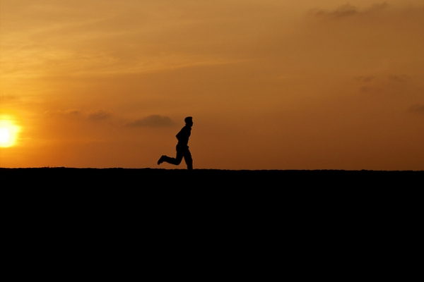 A young man takes off running as the sun sets over Galle Forte in Southern Sri Lanka on January 9, 2012. (Photosightfaces/Flickr)