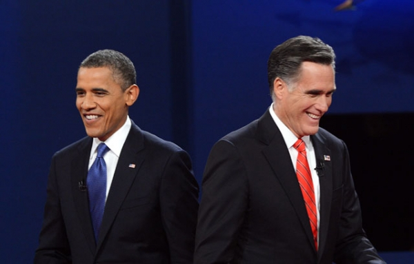 U.S. President Barack Obama (L) and former Massachusetts Governor Mitt Romney finish their debate at the University of Denver in Denver, CO on Oct. 3, 2012. (Saul Loeb/AFP/GettyImages)