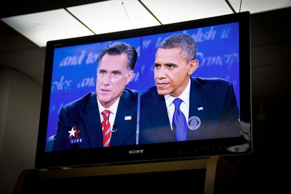 Governor Mitt Romney (L) and U.S. President Barack Obama (R) squaring off in the third 2012 U.S. Presidential debate, as seen at a debate viewing party in Covina, Virginia on Oct. 22, 2012. (Neon Tommy/Flickr)