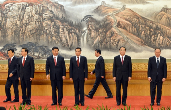 The new Politburo Standing Committee members (Xi Jinping, 3rd from left) meet the press at the Great Hall of the People in Beijing on November 15, 2012. (Mark Ralston/AFP/Getty Images)
