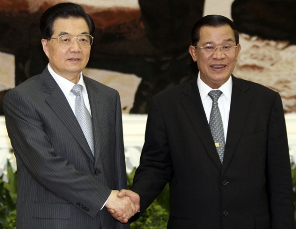 Then-President of China Hu Jintao (L) is welcomed by Cambodian Prime Minister Hun Sen (R) in Phnom Penh on March 31, 2012. Hu arrived in the Cambodian capital on a state visit to bolster ties between the already-close nations. (Pring Samrang/AFP/Getty Images)