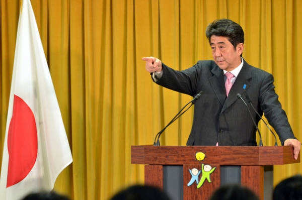 Incoming Japanese prime minister Shinzo Abe points to a journalist during a press conference at the LDP headquarters in Tokyo on December 17, 2012. (Yoshikazu Tsuno/AFP/Getty Images)