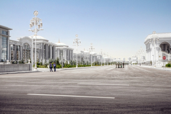 Beautifully smooth tarmac and well-kept buildings line the deserted streets Ashgabat, Turkmenistan on January 16, 2013. (Neil Melville-Kenney/Flickr)