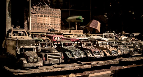 A row of vintage toy cars neatly lined up in an antique market stall in Shanghai, China on January 27, 2013. (ciaocibai/Flickr)
